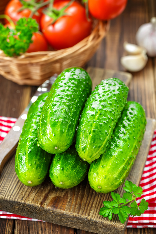 http://www.dreamstime.com/stock-photography-cucumbers-tomatoes-table-image40163462