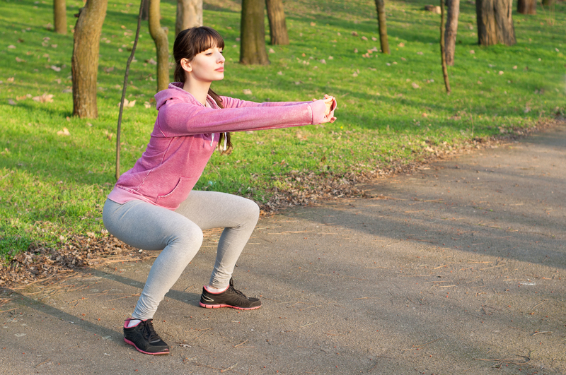 http://www.dreamstime.com/royalty-free-stock-photos-squat-exercises-strong-sporty-woman-doing-outdoors-fresh-air-park-sunny-spring-day-copy-space-image41034958