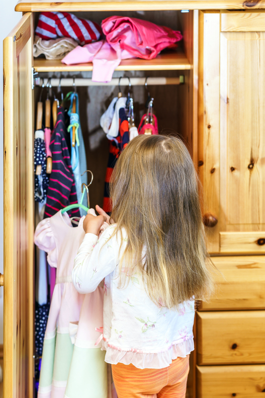 http://www.dreamstime.com/stock-photography-cute-little-girl-hanging-up-her-clothes-wardrobe-image41960592