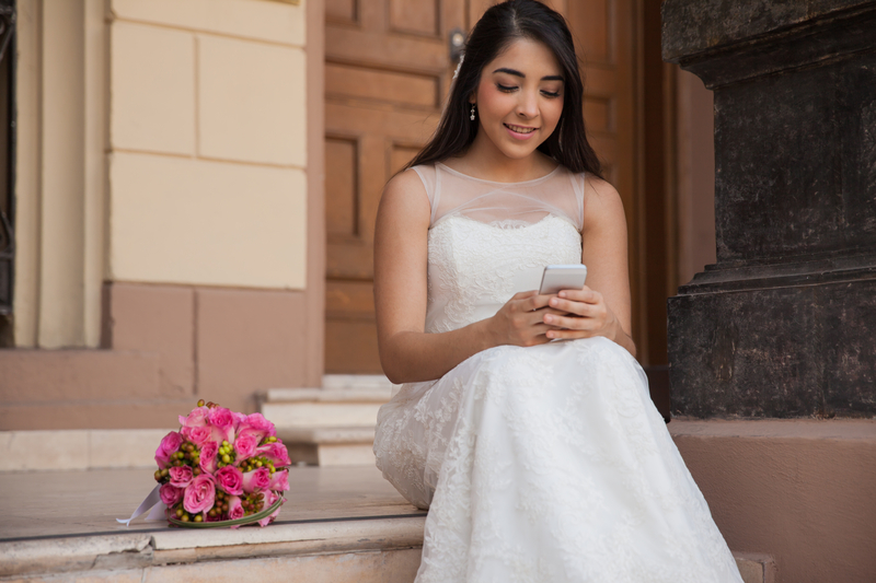 http://www.dreamstime.com/royalty-free-stock-photos-social-networking-my-wedding-cute-bride-texting-her-cell-phone-her-day-image42050518