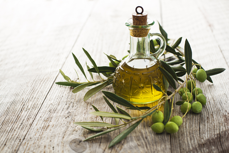 http://www.dreamstime.com/royalty-free-stock-photo-olive-oil-branch-wooden-table-image34567045