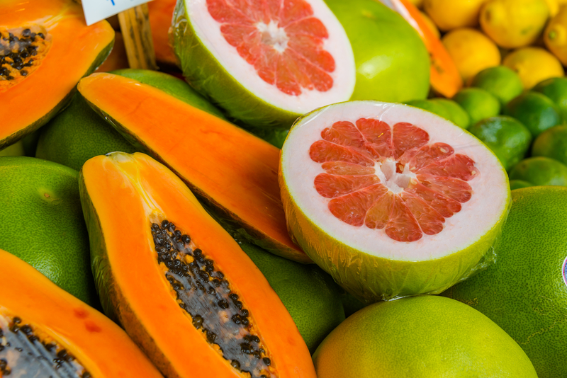 http://www.dreamstime.com/royalty-free-stock-photo-grapefruit-papaya-display-colorful-market-cut-open-showing-inside-image35260815