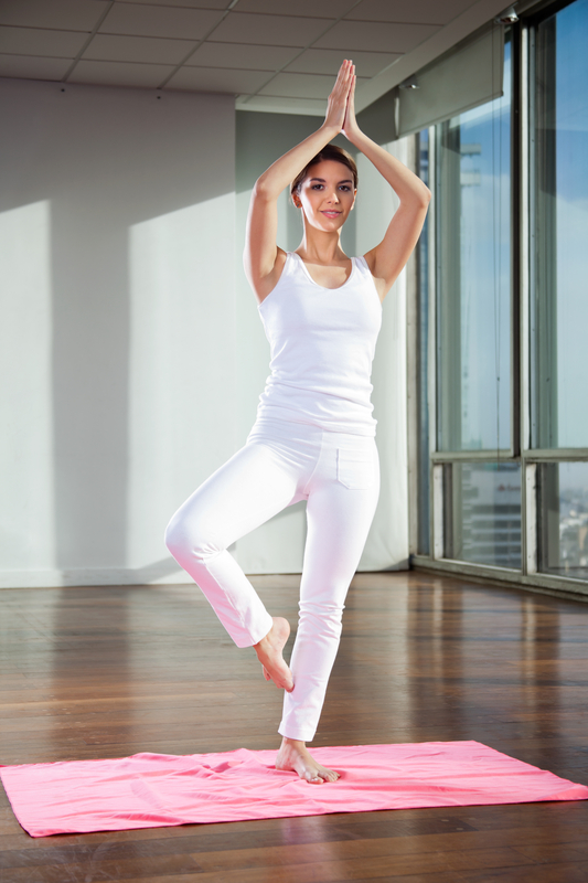 http://www.dreamstime.com/stock-photography-woman-tree-pose-mat-full-length-young-practicing-yoga-position-image36830772