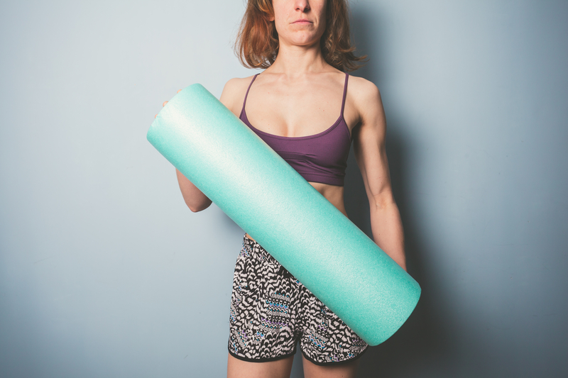 http://www.dreamstime.com/royalty-free-stock-images-athletic-young-woman-foam-roller-holding-exercise-image39290879