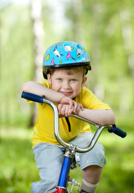 http://www.dreamstime.com/royalty-free-stock-photos-nice-kid-weared-helmet-bicycle-image25061218