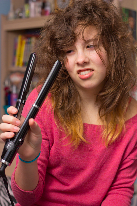 http://www.dreamstime.com/royalty-free-stock-images-girl-having-bad-hair-day-image29426129