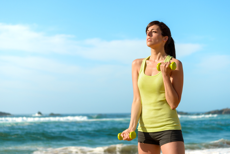 http://www.dreamstime.com/stock-photos-fitness-woman-training-biceps-beach-working-out-summer-sporty-girl-hard-dumbbells-sweaty-sport-caucasian-female-image30846083
