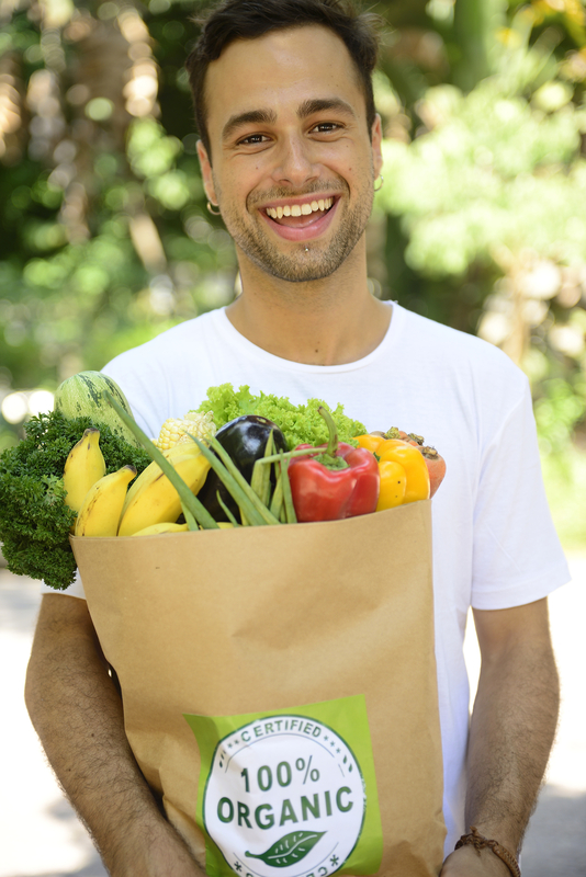 http://www.dreamstime.com/stock-image-happy-man-carrying-bag-organic-food-full-image38377061
