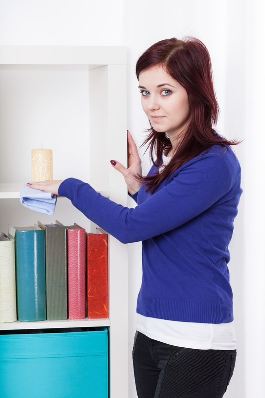 http://www.dreamstime.com/stock-images-young-woman-dusting-bookcase-beautiful-vertical-image40981254