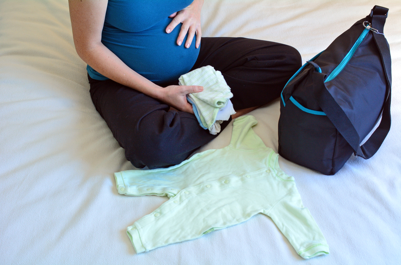 http://www.dreamstime.com/stock-photos-pregnancy-pregnant-woman-packing-hospital-bag-concept-photo-life-style-health-care-copy-space-image41823923