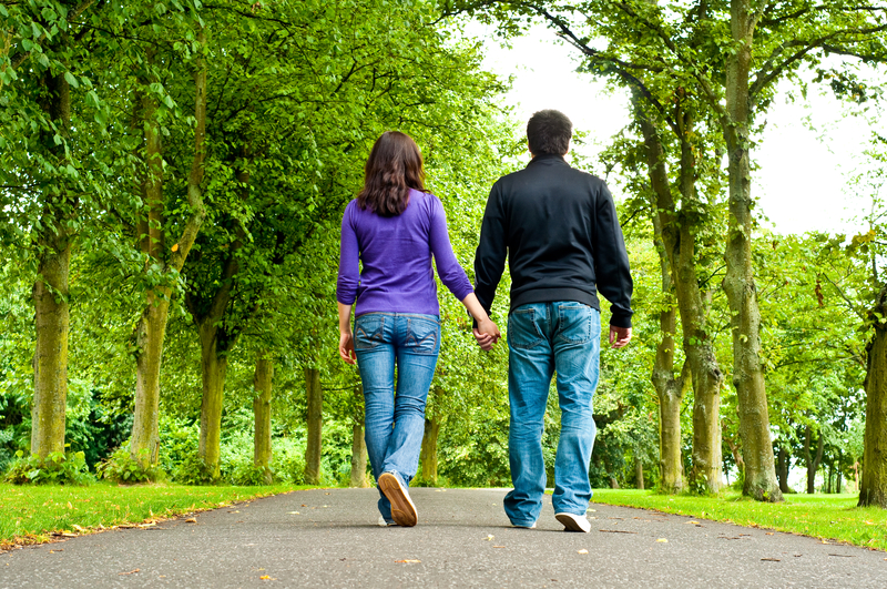 http://www.dreamstime.com/royalty-free-stock-image-couple-holding-hands-walking-park-image15421956