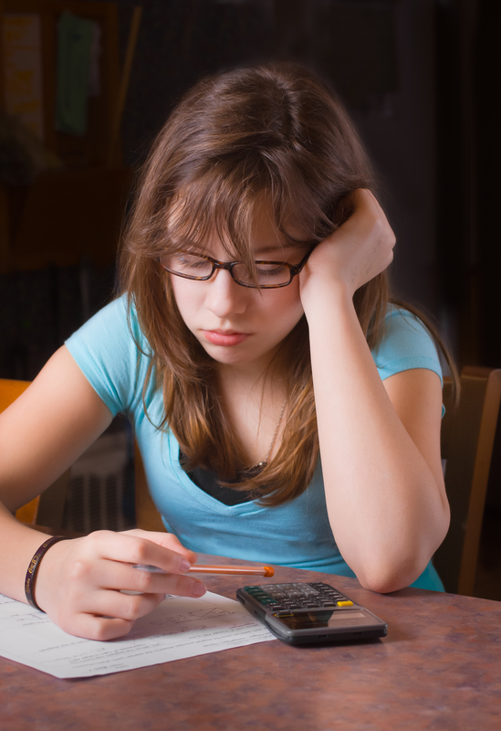 http://www.dreamstime.com/stock-photos-girl-doing-homework-image18995793