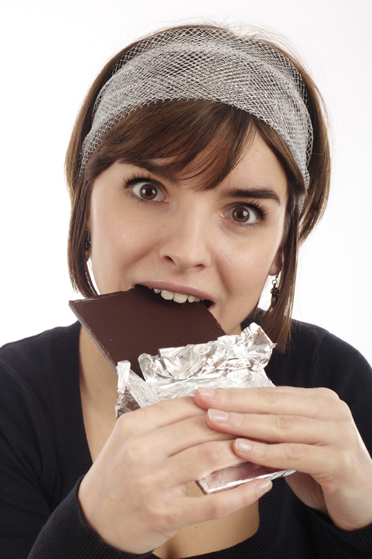 http://www.dreamstime.com/royalty-free-stock-photography-pretty-young-woman-eating-chocolate-image1992427