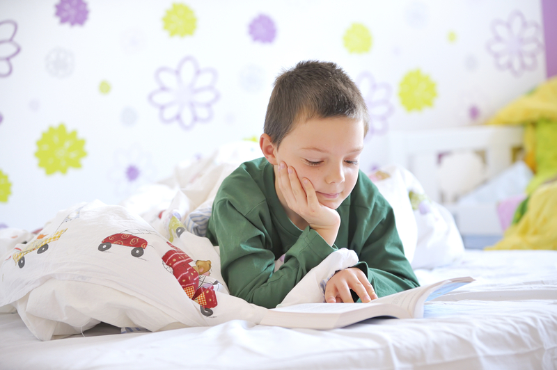 http://www.dreamstime.com/stock-photos-young-boy-his-bed-reading-book-image22310543