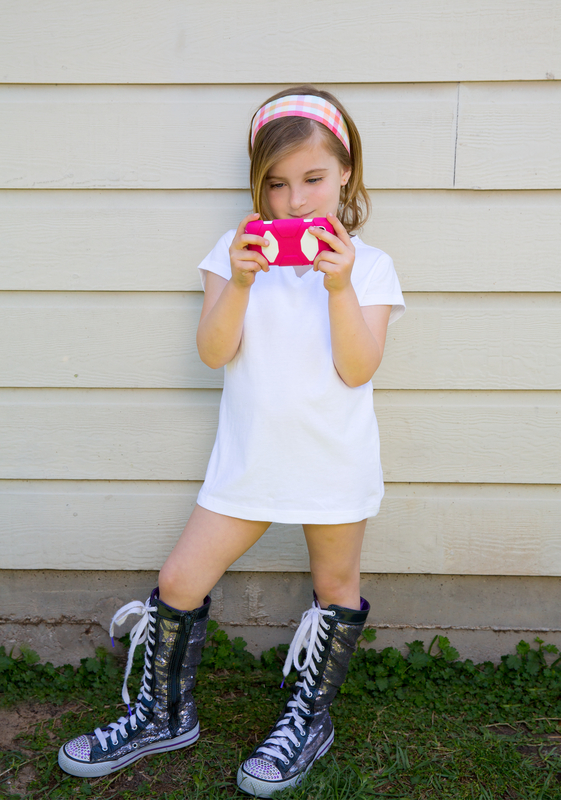 http://www.dreamstime.com/royalty-free-stock-image-blond-little-fashion-kid-girl-playing-smartphone-pink-image31371456