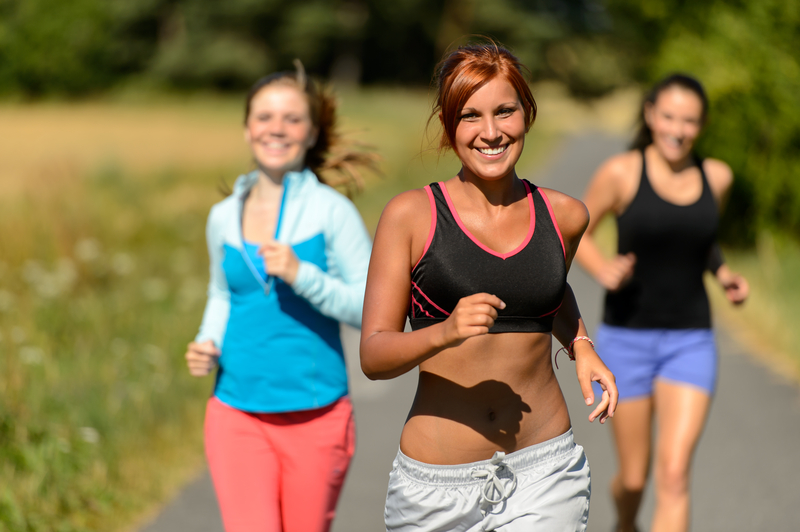 http://www.dreamstime.com/royalty-free-stock-photo-three-friends-running-outdoors-smiling-sunny-day-image38688035