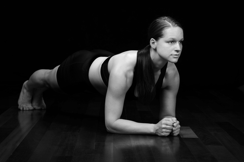 http://www.dreamstime.com/stock-image-woman-planking-working-out-isolated-black-background-image40908201