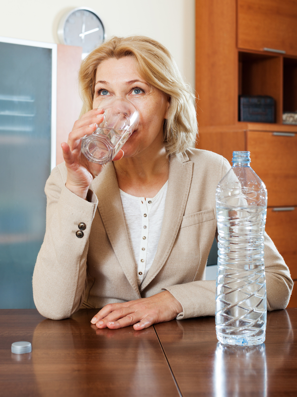 http://www.dreamstime.com/royalty-free-stock-image-blonde-mature-woman-drinking-water-glass-home-image42255796