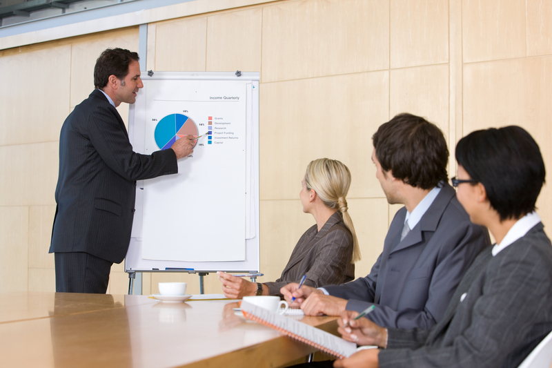 http://www.dreamstime.com/royalty-free-stock-images-confident-business-man-giving-presentation-to-coll-image8690079