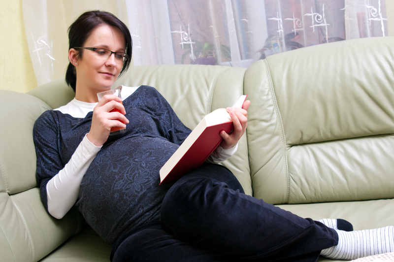 http://www.dreamstime.com/stock-photos-pregnant-woman-reading-image14007133