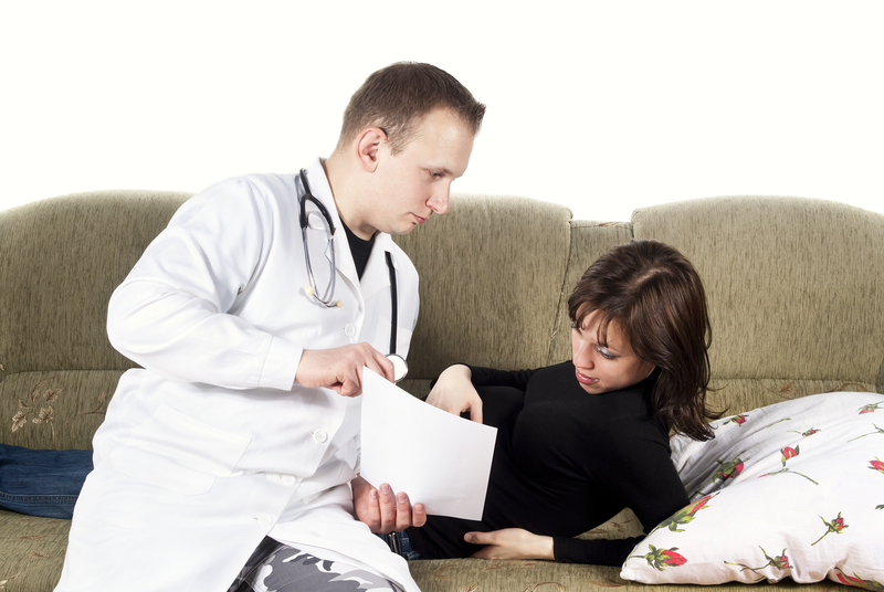 http://www.dreamstime.com/stock-photography-pregnant-woman-doctor-couch-image24540762