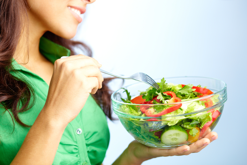 http://www.dreamstime.com/royalty-free-stock-photography-eating-salad-close-up-pretty-girl-fresh-vegetable-image30954637