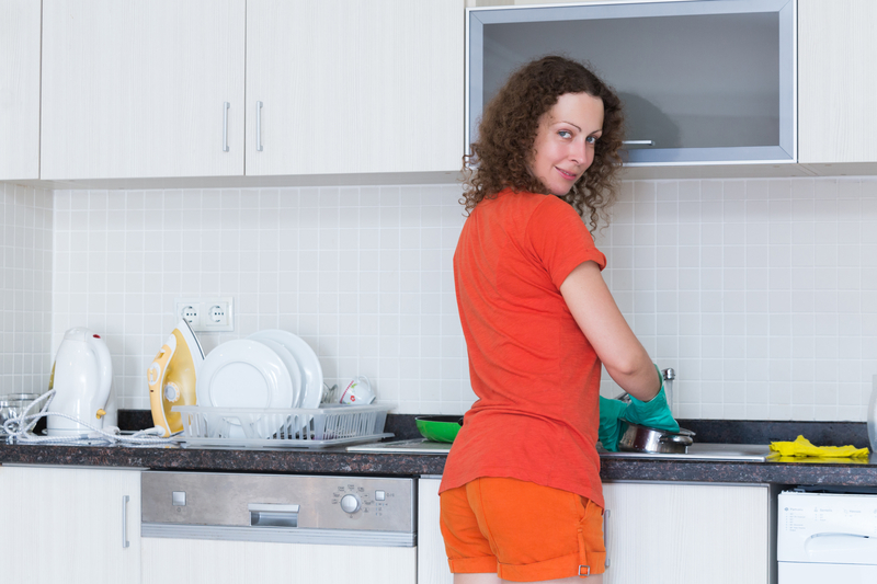 http://www.dreamstime.com/stock-images-housewife-washing-dishes-rubber-gloves-smiling-image31682244