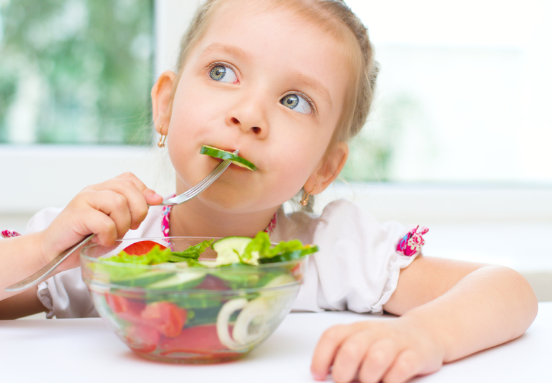 http://www.dreamstime.com/stock-photos-child-eating-vegetable-salad-little-cute-girl-image33648983