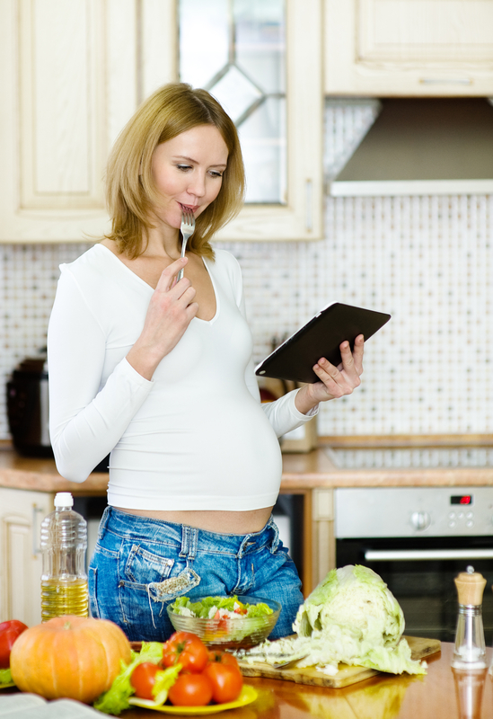 http://www.dreamstime.com/stock-photos-pregnant-woman-using-tablet-computer-to-cook-her-kitchen-image35083373