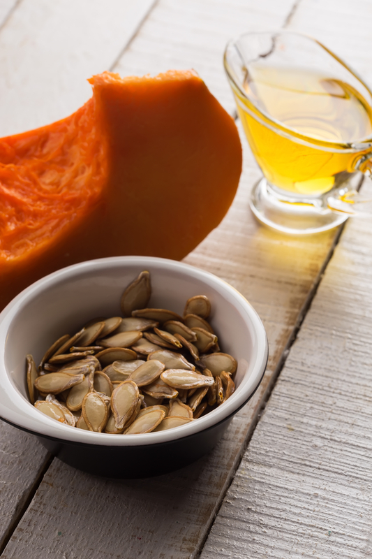 http://www.dreamstime.com/royalty-free-stock-photo-pumpkin-seeds-oil-bowl-white-wooden-table-selective-focus-image35869005