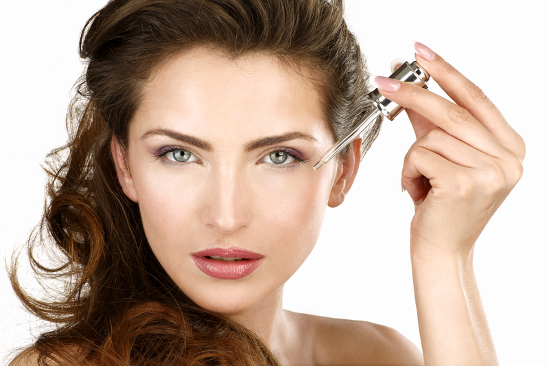 http://www.dreamstime.com/royalty-free-stock-images-closeup-beautiful-woman-applying-beauty-treatment-white-image37119969