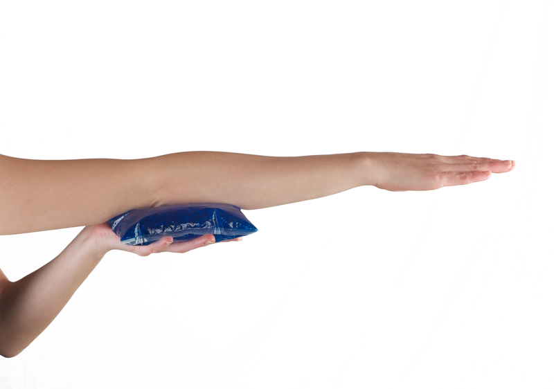 http://www.dreamstime.com/royalty-free-stock-image-holding-ice-gel-pack-elbow-medical-concept-photo-woman-image39252856