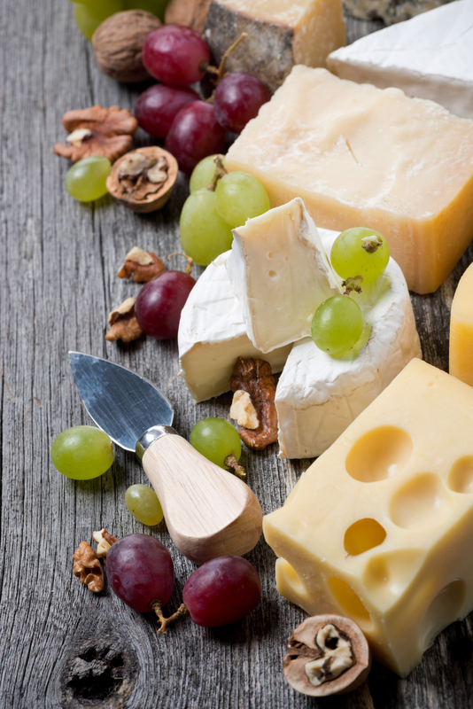 http://www.dreamstime.com/stock-photography-cheeses-grapes-walnuts-wooden-background-top-view-vertical-image40199592