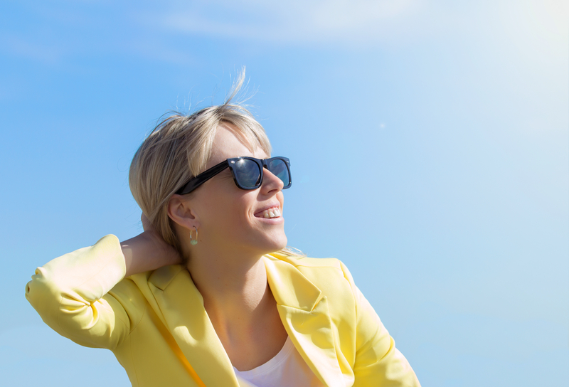 http://www.dreamstime.com/royalty-free-stock-photo-woman-wearing-sunglasses-happy-young-bright-sun-image40512545