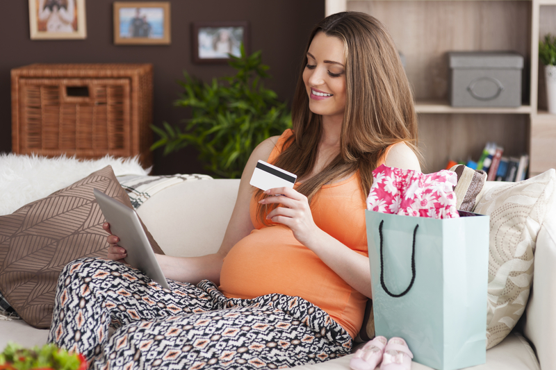 http://www.dreamstime.com/stock-photos-pregnant-woman-online-shopping-enjoying-digital-tablet-image43070543