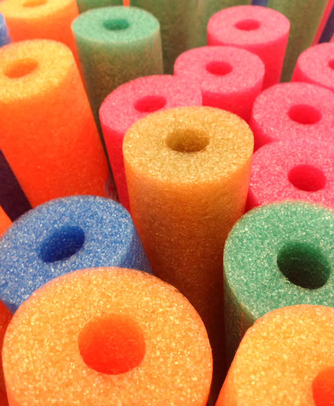 http://www.dreamstime.com/stock-image-coloured-foam-pool-noodles-abstract-background-stacked-colored-as-used-beach-image43187041