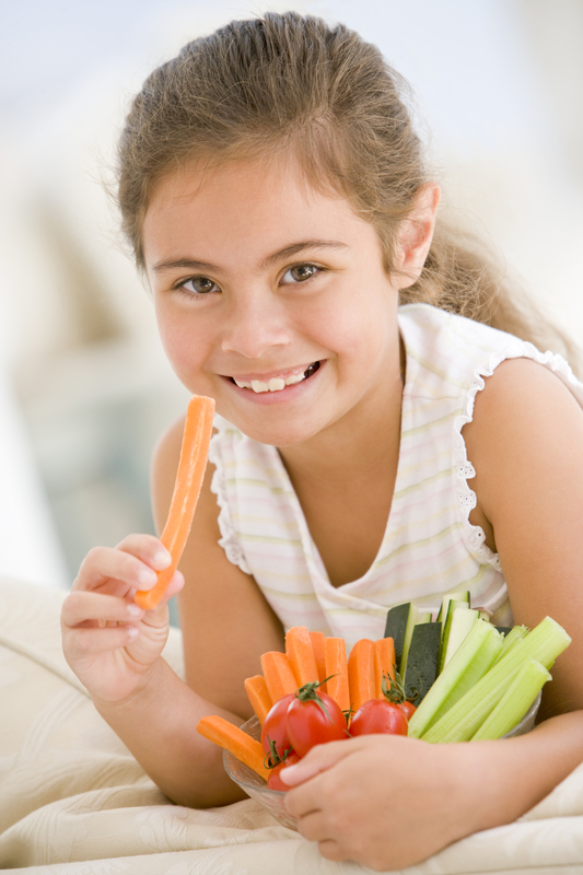 http://www.dreamstime.com/stock-photography-young-girl-eating-bowl-vegetables-image5939142