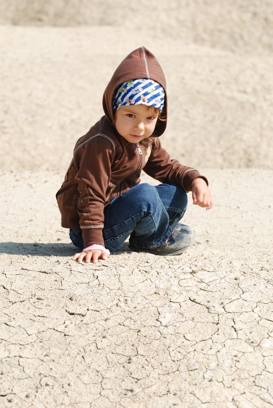 http://www.dreamstime.com/stock-photos-cute-toddler-playing-dirt-image3422963