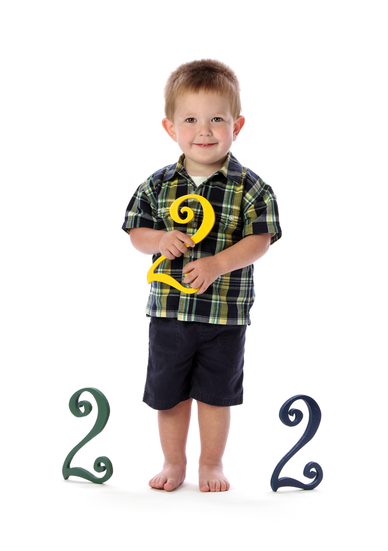 http://www.dreamstime.com/stock-photography-two-year-old-holds-number-two-image23880142