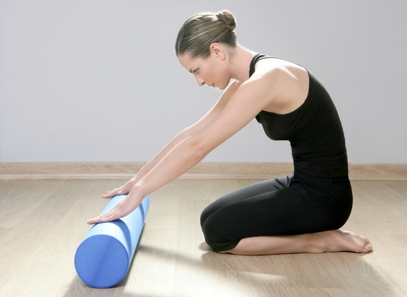 http://www.dreamstime.com/stock-photos-blue-foam-roller-pilates-woman-sport-fitness-image18933773