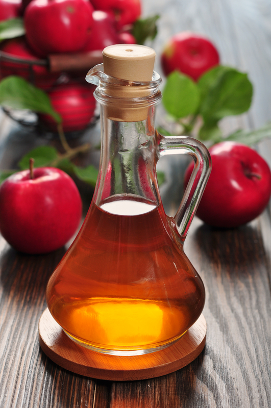 http://www.dreamstime.com/royalty-free-stock-photography-apple-cider-vinegar-glass-bottle-basket-fresh-apples-image33174347