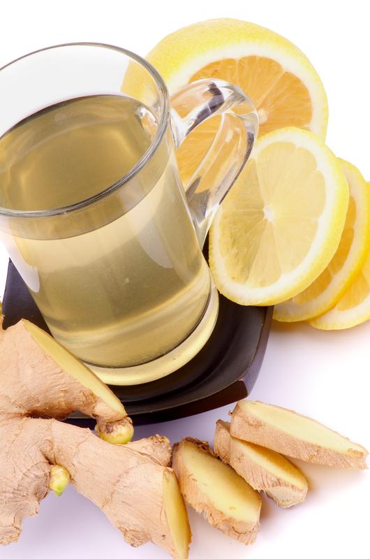 http://www.dreamstime.com/stock-image-ginger-lemon-tea-arrangement-glass-cup-slices-closeup-white-background-image32901321