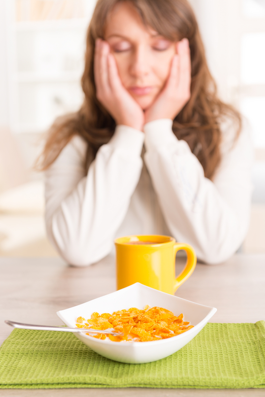 http://www.dreamstime.com/stock-photos-sleepy-woman-eating-breakfast-home-image37611463