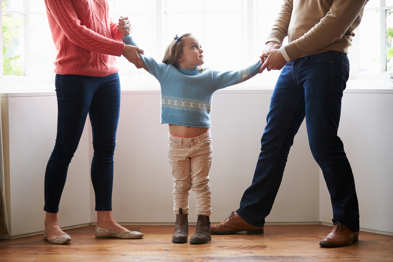 http://www.dreamstime.com/royalty-free-stock-photo-two-parents-fighting-over-child-divorce-concept-young-image36608595