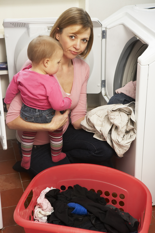 http://www.dreamstime.com/royalty-free-stock-photo-woman-doing-laundry-holding-daughter-image8688015