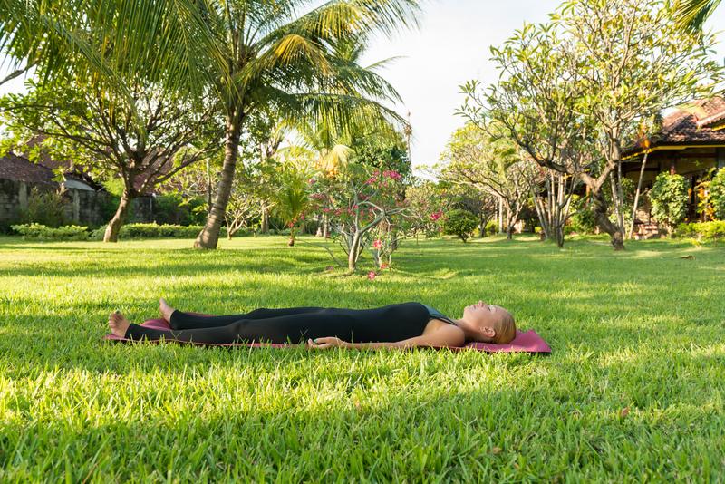 http://www.dreamstime.com/stock-image-woman-doing-yoga-garden-shavasana-young-exercises-lush-tropical-image31538471