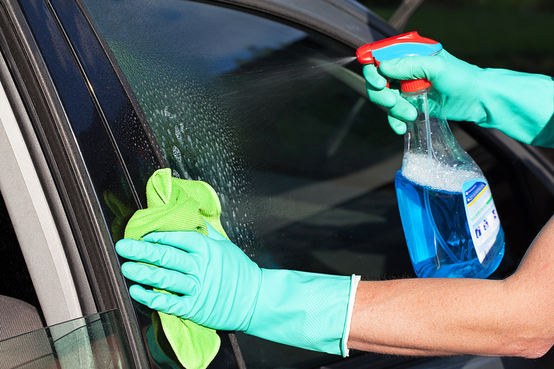 http://www.dreamstime.com/royalty-free-stock-photography-car-window-washing-man-s-using-rag-spray-image36185147