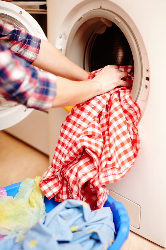 http://www.dreamstime.com/royalty-free-stock-image-housewife-s-hands-putting-laundry-washing-machine-closeup-image36397636
