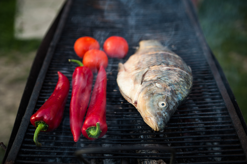 http://www.dreamstime.com/royalty-free-stock-photo-fish-grill-raw-freshwater-cooked-traditional-style-vegetables-image40340595