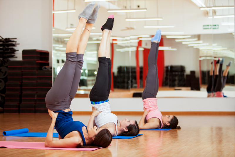 http://www.dreamstime.com/stock-image-practicing-few-yoga-poses-three-pretty-young-women-shoulderstand-pose-gym-image35911901